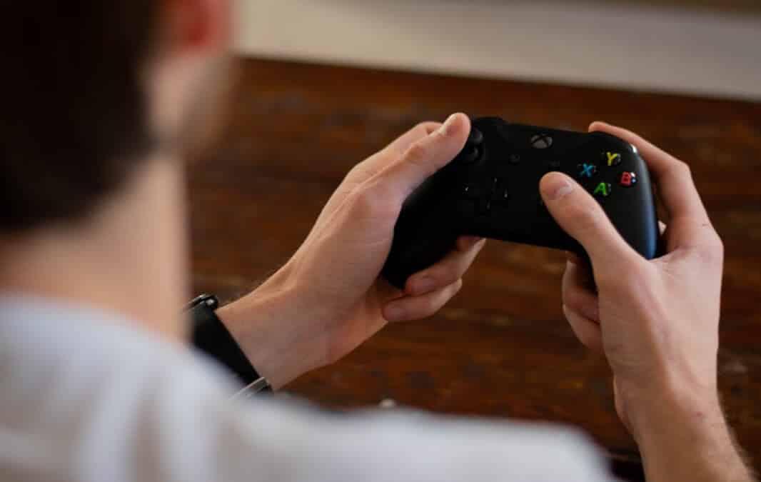 a person holding an xbox controller